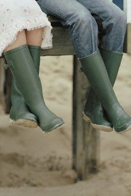 Couple wearing green galoshes []
