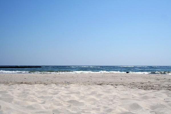 и после  намывки песка []